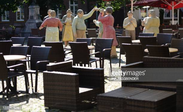 Sculptures stand at a restaurant in the city of Rheda-Wiedenbrueck, western Germany on June 23, 2020. - After a coronavirus outbreak at a...