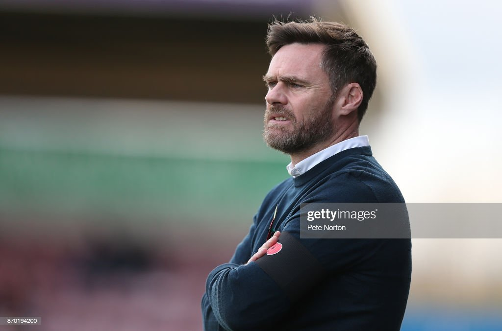 Scunthorpe United manager Graham Alexander looks on during The Emirates FA Cup First Round match between Northampton Town and Scunthorpe United at Sixfields on November 4, 2017 in Northampton, England.