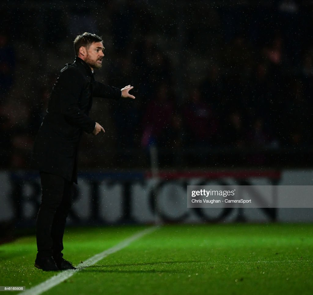 Scunthorpe United manager Graham Alexander shouts instructions to his team from the technical area during the Sky Bet League One match between Scunthorpe United and Blackburn Rovers at Glanford Park on September 12, 2017 in Scunthorpe, England.