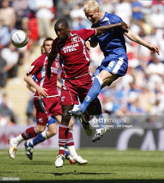 Scunthorpe United's Jonathan Forte and Millwall's Zak Whitbread battle for the ball