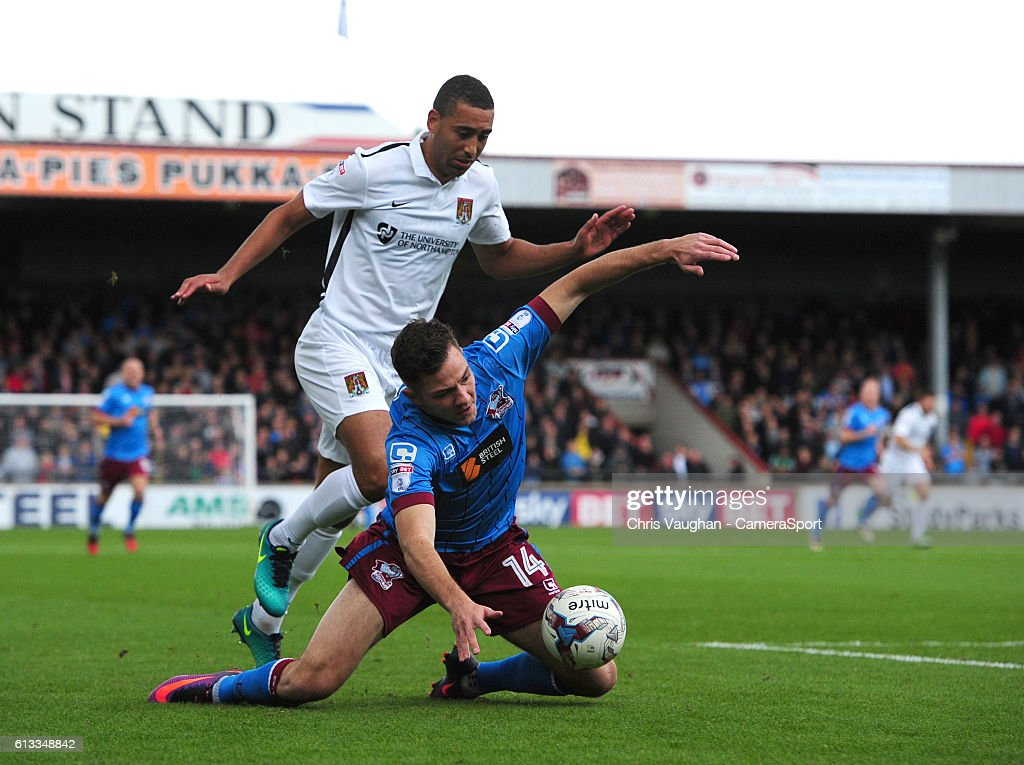 Scunthorpe United's Tom Hopper is fouled by Northampton Town's Lewin Nyatanga during the Sky Bet League One match between Scunthorpe United and Northampton Town at Glanford Park on October 8, 2016 in Scunthorpe, England.