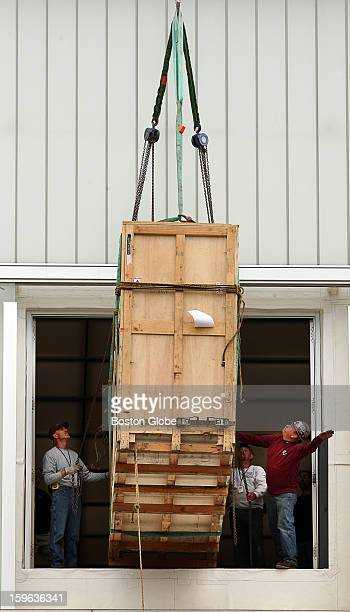 SCurve a sculpture by Anish Kapoor arrives at the Institute of Contemporary Art via hoisting by a Shaughnessy and Ahern Co crane for an exhibit that...