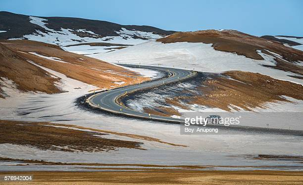 S-curve Road With A Car In Northern Iceland.