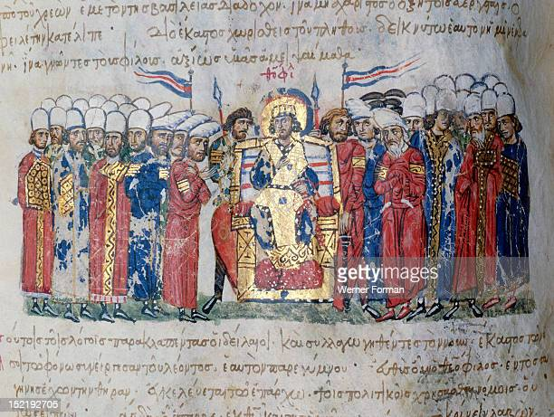 Scylitzes chronicle, Fol.42.v. Theophilus making a proclamation. He is flanked by his bodyguard who are bare headed. Ranks of officials are...