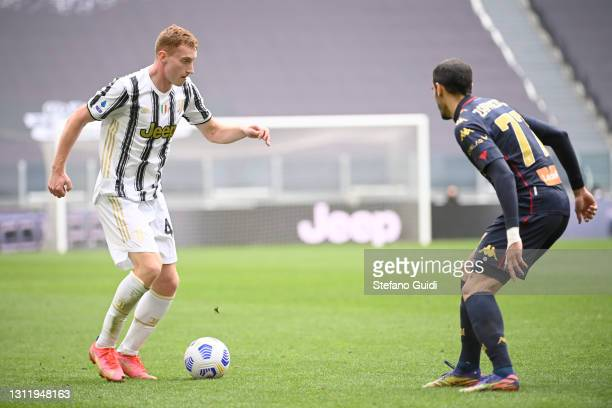 SDejan Kulusevski of Juventus FC against Davide Zappacosta of Genoa CFC during the Serie A match between Juventus and Genoa CFC at Allianz Stadium on...