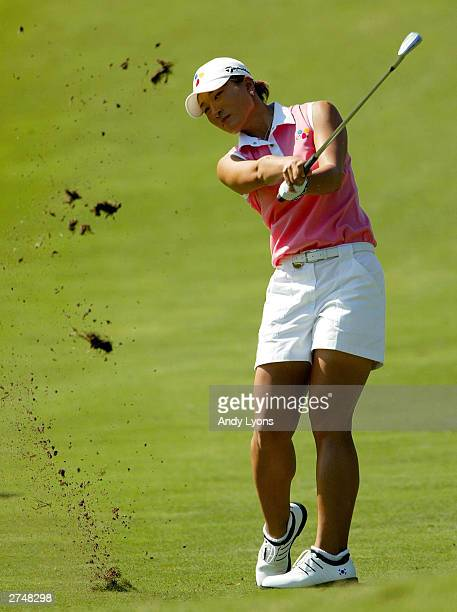 Se Ri Pak of Korea hits her second shot on the par 4 1st hole during the ADT Championship on November 20, 2003 at the Trump International Golf Club...