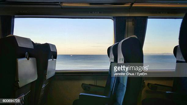 sea against sky seen through train window - vehicle seat stock pictures, royalty-free photos & images