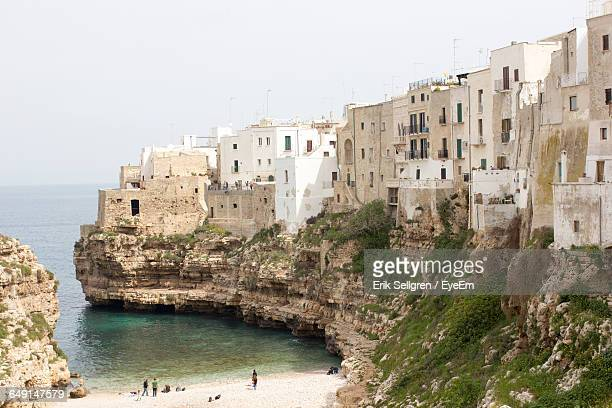 sea and buildings at apulien - polignano a mare stock photos and pictures