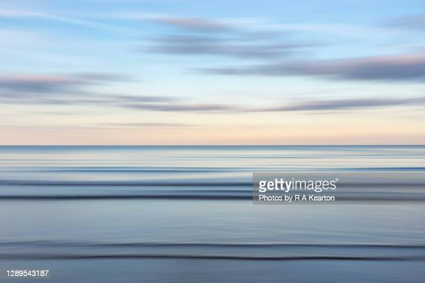 sea and sky abstract at dusk - coastline stock pictures, royalty-free photos & images