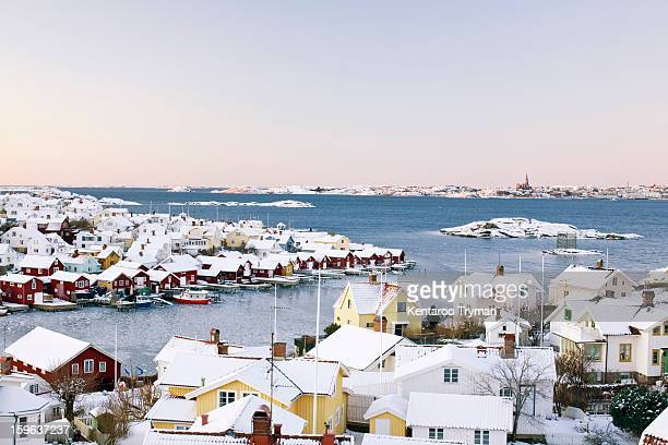Sea and snow covered houses in winter