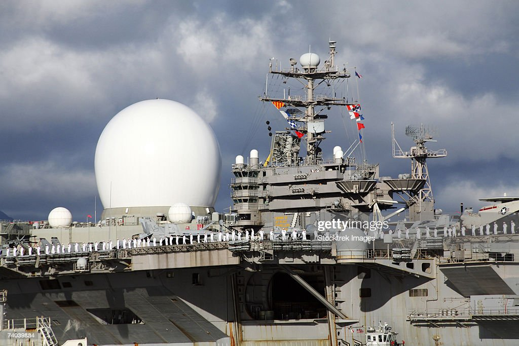 Sea Based X-band Radar appears to be part of the USS Abraham Lincoln looking like the big brother to the smaller radars on the aircraft carrier as ship personnel man the rails during transit into Pearl Harbor, Oahu, Hawaii. : Stock Photo