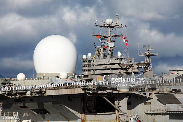 sea based x-band radar appears to be part of the uss abraham lincoln looking like the big brother to the smaller radars on the aircraft carrier as ship personnel man the rails during transit into pearl harbor, oahu, hawaii. - pearl harbor naval shipyard stock photos and pictures