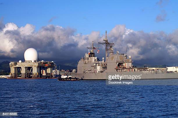 sea based x-band radar dome modeled by the setting sun at pearl harbor naval shipyard where this component of the ballistic missile defense system is undergoing maintenance and repair. - pearl harbor naval shipyard stock photos and pictures