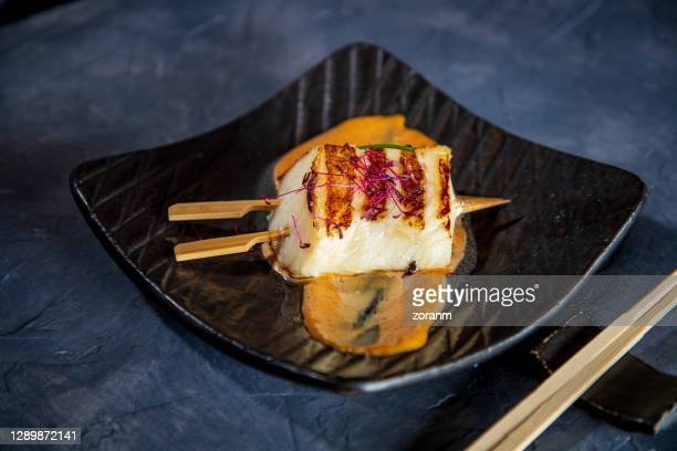 sea bass fillet on miso barbeque sauce in plate - miso sauce stock pictures, royalty-free photos & images