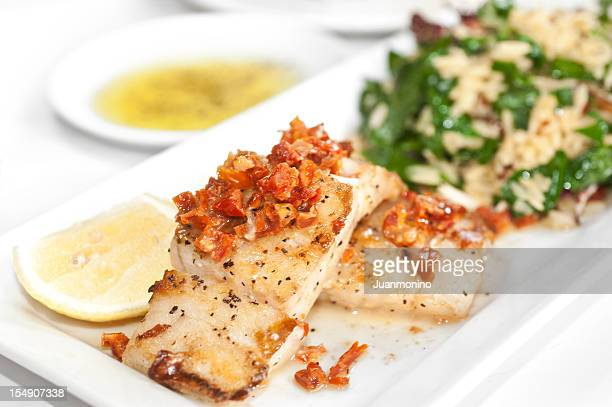 sea bass in sundried tomato sauce - course meal stock pictures, royalty-free photos & images