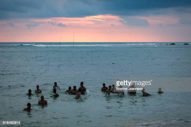 Sea bathing at sunset, Sri Lanka