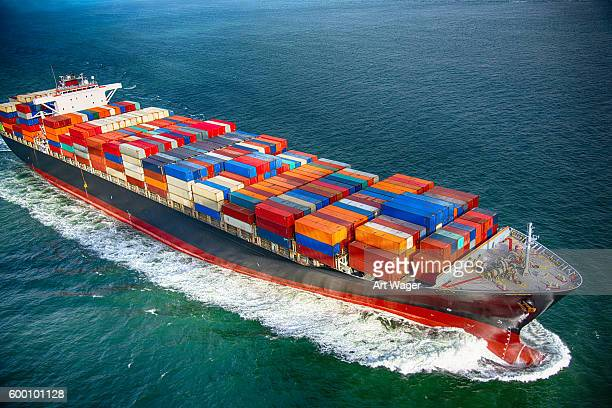 sea bearing cargo ship - heavy industry stock photos and pictures