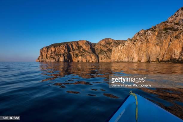 Sea, Boat & Cliff