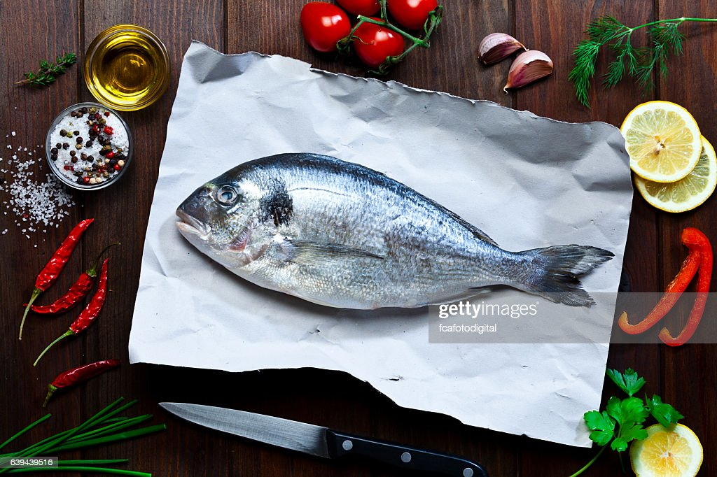 Sea bream and ingredients for cooking and seasoning : Stock Photo