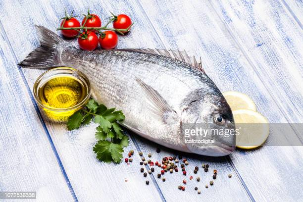 Sea bream and ingredients for seasoning and cooking fish