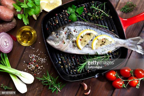Sea bream in a cooking pan