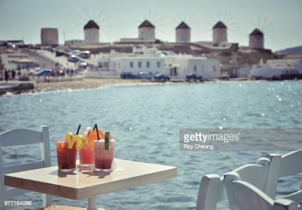 Sea Breeze cocktails on table on seashore, Mykonos, Cyclades, South Aegean, Greece