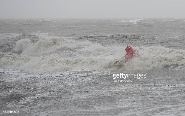 A sea buoy is buffeted by strong waves off the coastline on April 12 2014 in Port Douglas Australia The cyclone crossed the coast of Cooktown...