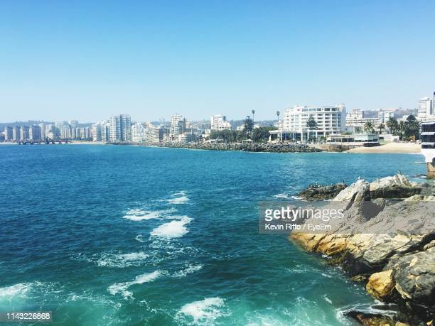 sea by buildings against clear blue sky - vina del mar stock pictures, royalty-free photos & images