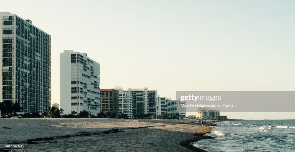 Sea By Cityscape Against Clear Sky : Stock Photo