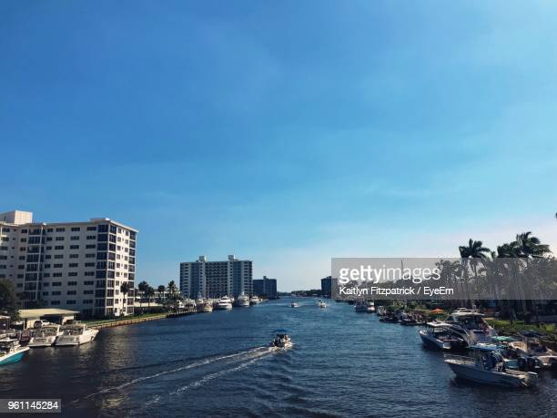 sea by cityscape against sky - delray beach stock pictures, royalty-free photos & images