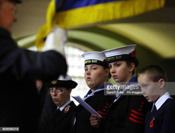 Sea Cadets watch a standard bearer during a memorial service held at the Royal Dockyard Church in the Historic Dockyard Chatham Kent remembering...