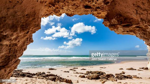 sea cave in western sahara - tide stock pictures, royalty-free photos & images