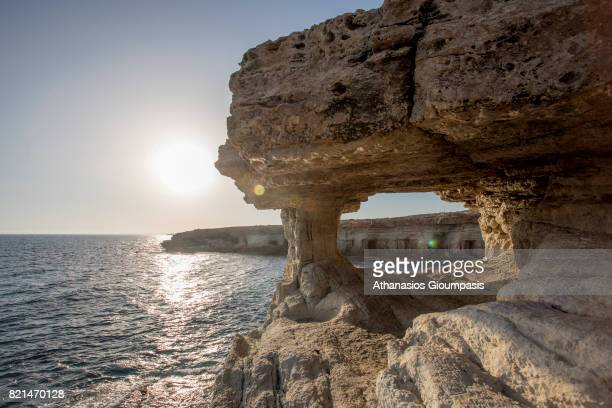 Sea Caves at the sunset in Cape Greco on July 11 2017 in Ayia Napa Cyprus The Sea Caves located in Cape Greco or Cavo Greco and is a headland in the...