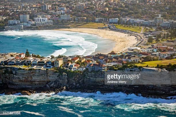sea cliff and bondi beach, sydney, australia - bondi beach stock pictures, royalty-free photos & images