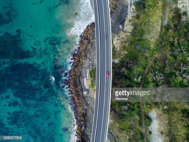 sea cliff brug antenne - luchtfoto stockfoto's en -beelden