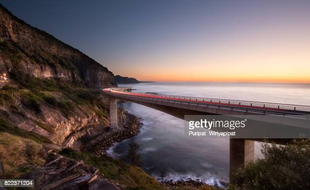 sea cliff bridge wollongong - wollongong stock pictures, royalty-free photos & images