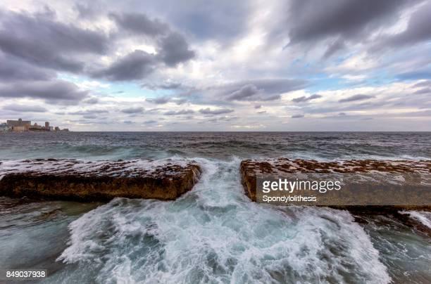 Sea crashing against the rocks alongside the Malecon, Havana, Cuba
