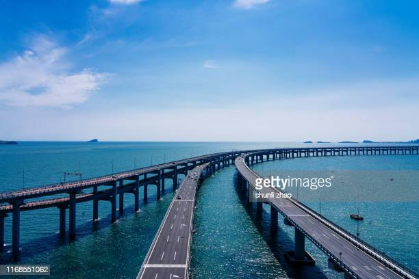 sea crossing bridge - diminishing perspective stock pictures, royalty-free photos & images