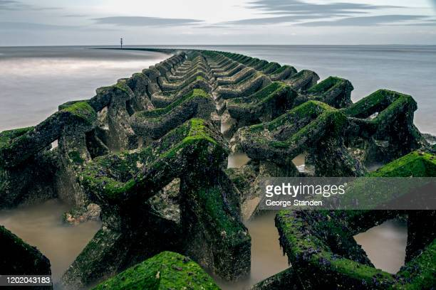 sea defence - north west england stock pictures, royalty-free photos & images