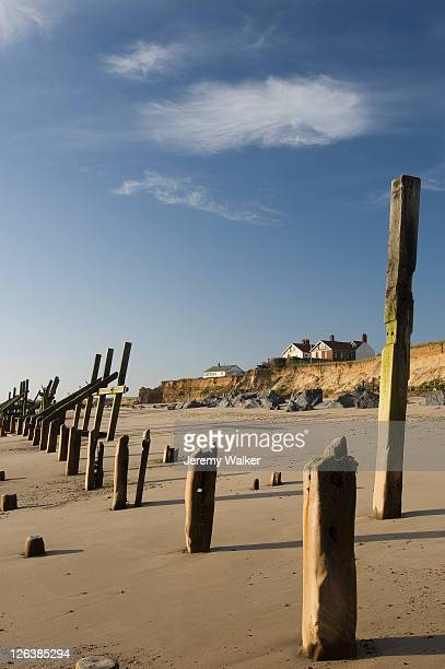 sea defences in a sandy beach at happisburgh in norfolk. - east stock pictures, royalty-free photos & images