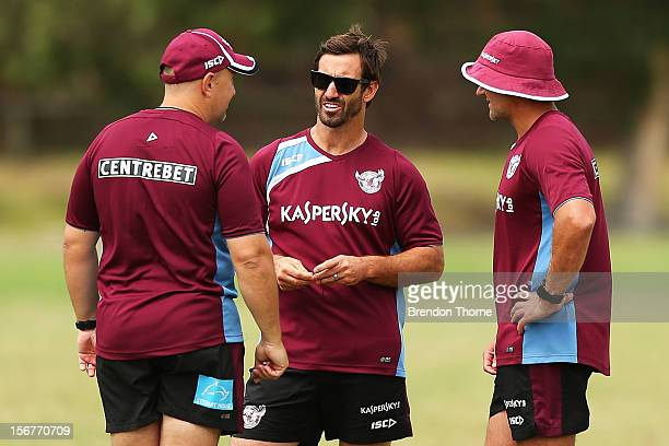 Sea Eagles assistant coach Andrew Johns speaks with coaching staff during a Manly Sea Eagles NRL preseason training session at Sydney Academy of...