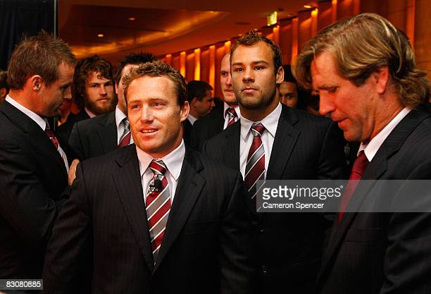 Sea Eagles captain Matt Orford team mate Brett Stewart and coach Des Hasler relax prior to the 2008 NRL Grand Final breakfast at the Westin hotel on...