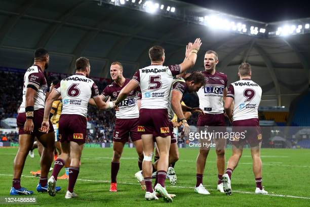 Sea Eagles celebrate a try by Reuben Garrick during the round 15 NRL match between the Gold Coast Titans and the Manly Sea Eagles at Cbus Super...
