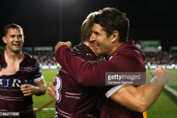 Sea Eagles coach Trent Barrett embraces Jake Trbojevic of the Sea Eagles after winning the round 26 NRL match between the Manly Sea Eagles and the...