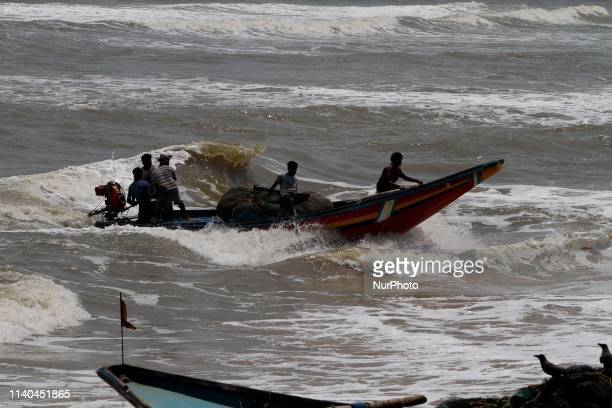 Sea fishing boats are seen at the Konark beach of Puri district and fishermen prepares to ashore their boats to the beach as they withdraw from the...