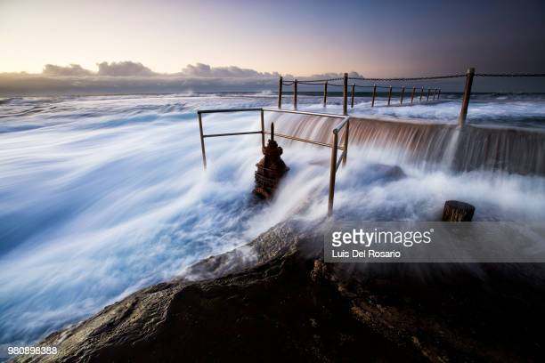 sea flooding pier, mona vale beach, new south wales, australia - mona wales stock pictures, royalty-free photos & images