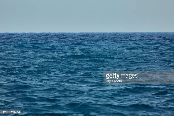 sea floor stock photo. smooth pacific ocean with blue color. - océano pacífico fotografías e imágenes de stock