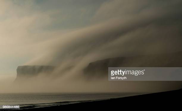 Sea fog and low cloud shroud cliffs on June 29 2018 in SaltburnByTheSea England Low cloud and sea fog will cover many areas along the East coast but...