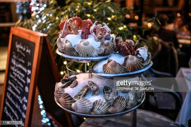 A sea food platter is displayed at an oyster bar on December 29 2019 in Paris