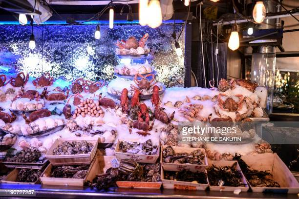 Sea food products are displayed on December 29 2019 at an oyster bar in Paris